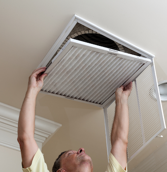 Changing air filters in ceiling