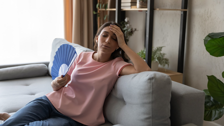 Woman on couch sweating