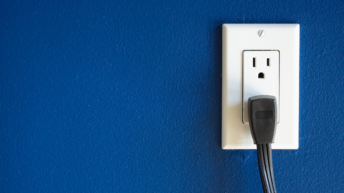 Electrical Outlet with an appliance plugged in